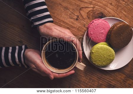 Hot Cup Of Coffee And Macaron Cookies In The Morning
