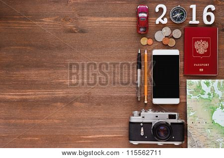 Travel Background 2016 Year. Different Things You Need For Journey - Smartphone, Passport, Camera,