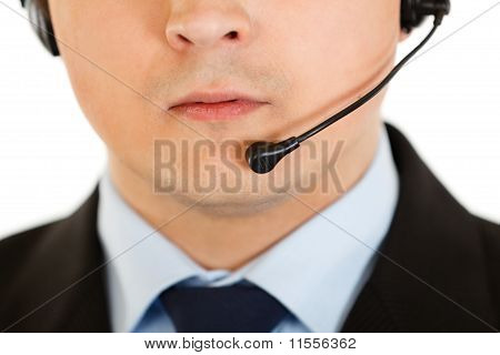 Thoughtful modern businessman with headset. Closeup.