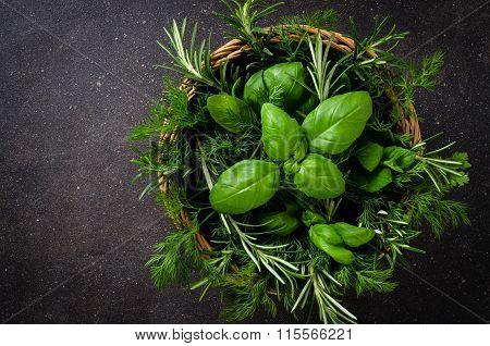 Mix of fresh herbs in wicker basket
