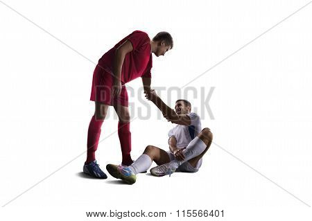 football soccer player help another one isolated background