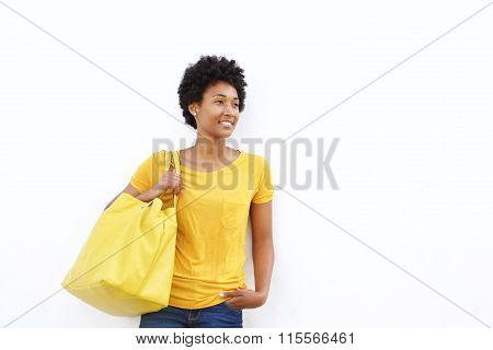 Beautiful Young Woman With A Handbag Looking At Copy Space