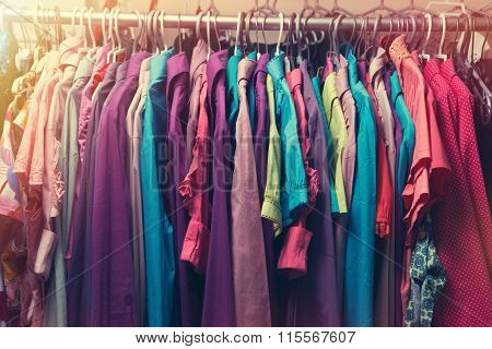 Clothes Hang On A Shelf In A Designer Clothes Store In Retro Colors