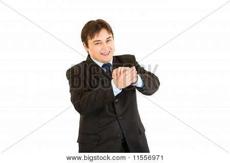Smiling young businessman cheerfully applauding isolated on white