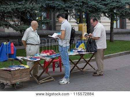 Kiev, Ukraine - September 19, 2015: Men Choose Patriotic Literature And Historical Content At The In