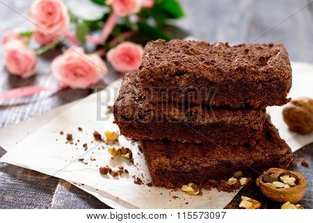 American Chocolate Cake With Walnut On A Dark Background