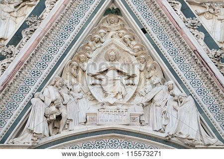 FLORENCE, ITALY - JUNE 05: Virgin Mary seated, surrounded by angels, Portal of Cattedrale di Santa Maria del Fiore (Cathedral of Saint Mary of the Flower), Florence, Italy on June 05, 2015