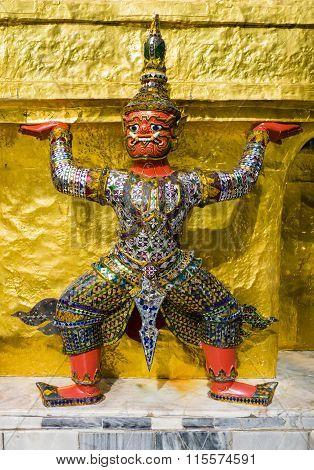 Red demon guardian supporting Wat Phra Kaew, Thailand