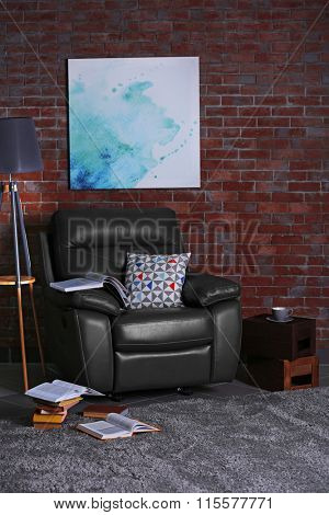 Leather armchair and floor lamp in living room