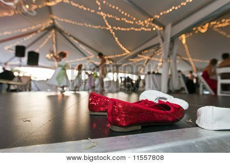 Red Shoes On A Dance Floor