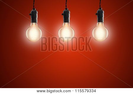 Idea Concept - Vintage Incandescent Bulbs On Red Background