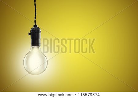 Idea Concept - Vintage Incandescent Bulb On Yellow Background
