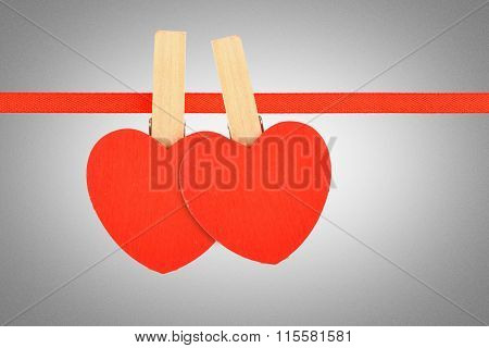 Two Red Hearts At Ribbon Over Grayscale Noise