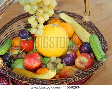 Wicker Basket With Fresh Fruit In Autumn