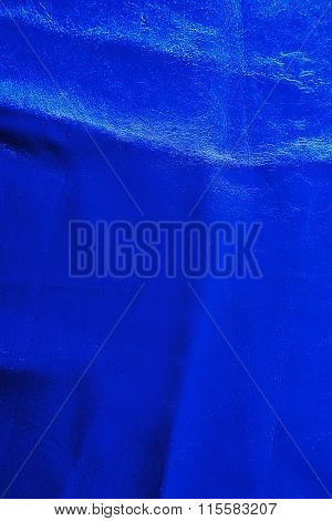 Blue leather texture with crumpled uneven surface