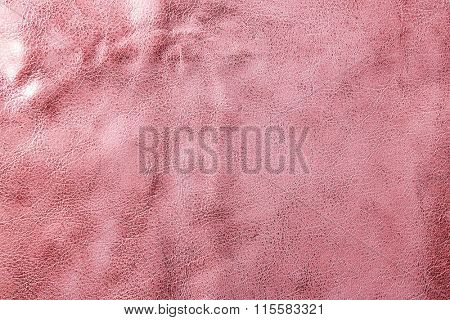 Pink leather texture with uneven surface