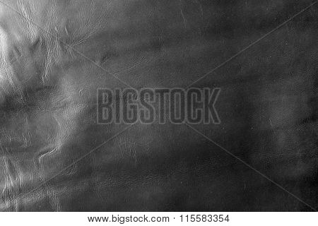 Black cloth texture with uneven crumpled surface