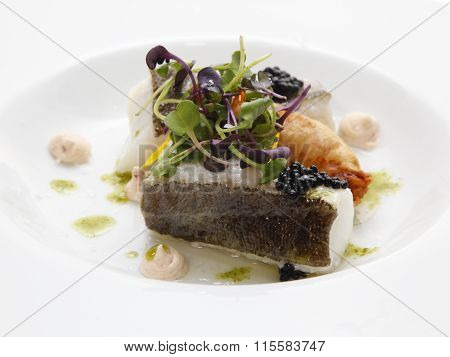Baked sea bass with vegetables