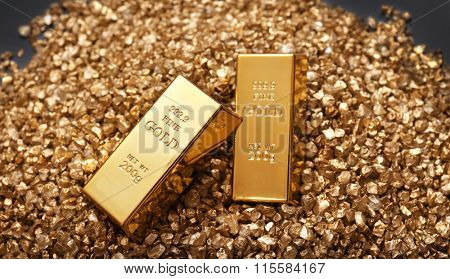 Gold bars on nugget grains background, close-up