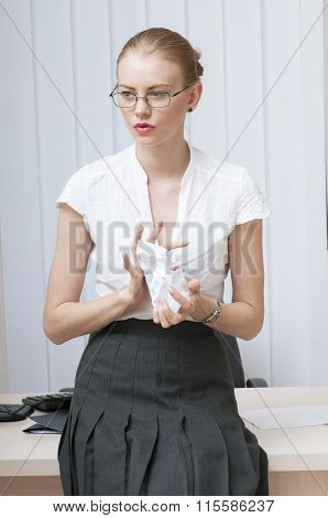 Young Secretary Dissatisfied, Crumples Paper.