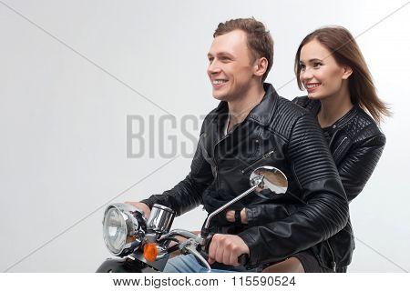 Cheerful boyfriend and girlfriend on motor bike
