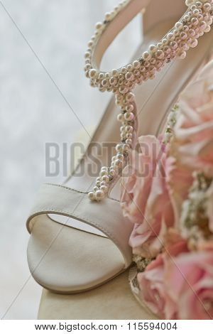 A Coloured Macro Photo Of A Detailed Bouquet With Pink Roses, White Small Flowers And White shoes