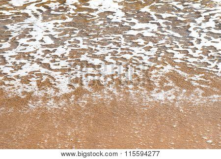 Surf. Close-up Of A Sea Foam And Sandy Coast