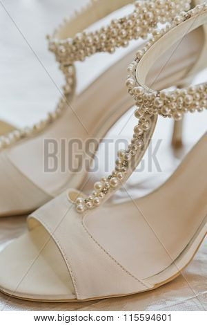 White Wedding Shoes Decorated With White Pearls