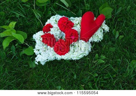 red heart and roses and white flowers