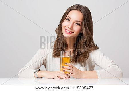 Happy Young Woman With Glass Of Fruit Juice.