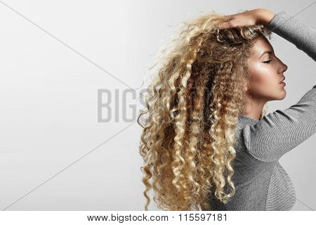 Beauty Young Woman With A Big Blondy Hair
