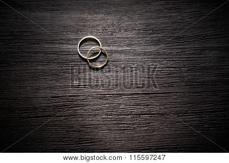 Couple Of Gold Wedding Rings On Black Background