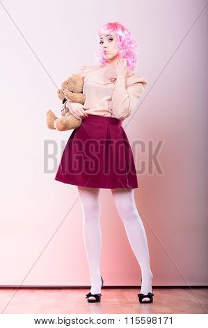Childlike Woman With Teddy Bear Toy