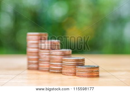 Stack Of Coin On Wood Table And Blur Background, Selective Focus
