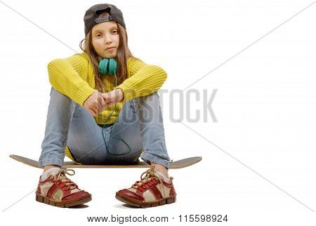 Pretty Young Girl Posing With A Skateboard, Seat On Skate