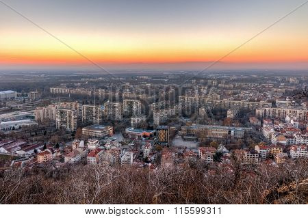 Panoramic Sunset view of city of Plovdiv from Dzhendem tepe hill