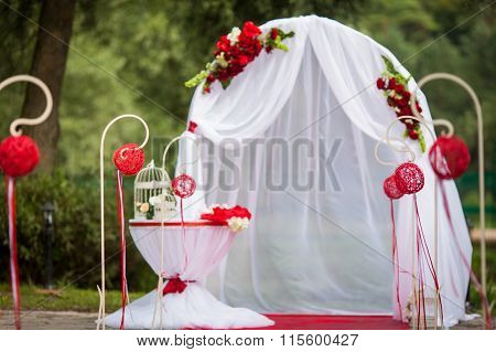 Romantic Valentyne Wedding Aisle In A Park With Red Decorations And Flowers