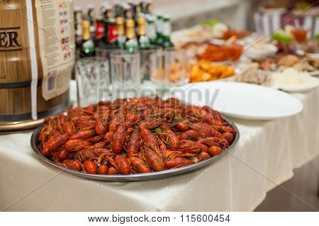 Closeup Of Traditional Ukrainian Wedding Reception Feast Table With Red Lobsters On A Platter