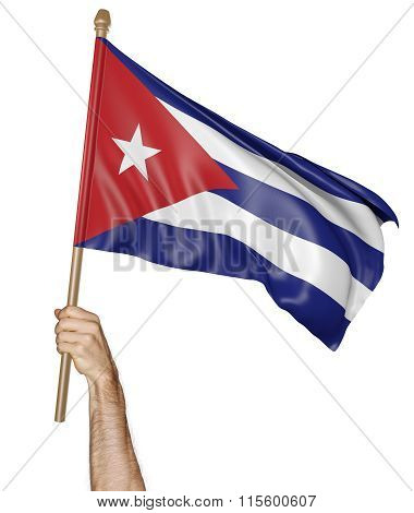 Hand proudly waving the national flag of Cuba