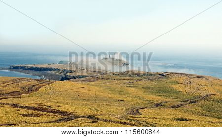 cape  Crillon in mist. Island Sakhalin
