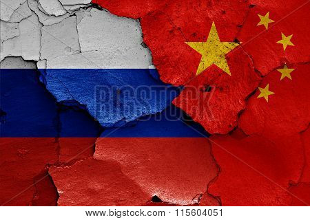 Flags Of Russia And China Painted On Cracked Wall