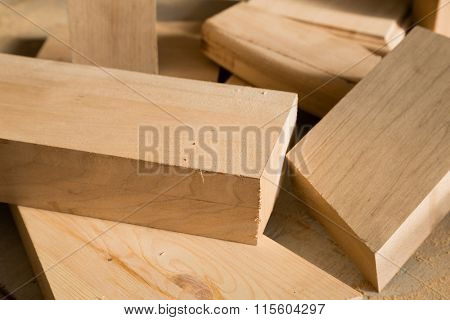 Wooden sticks on a bench in the carpentry workshop