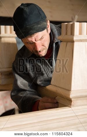 Carpenter checks to make furniture in the carpentry workshop