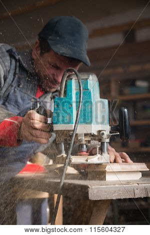 Joiner working of manual milling machine in the carpentry workshop