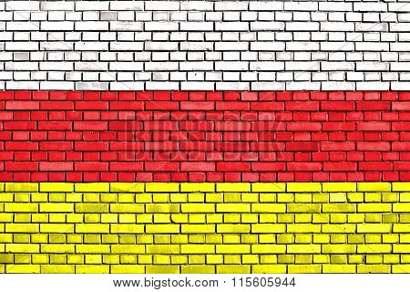 Flag Of North Ossetia Painted On Brick Wall