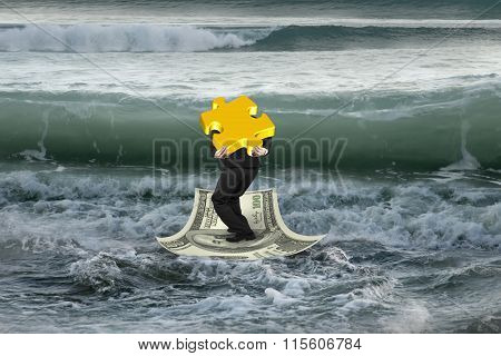 Businessman Carrying Gold Puzzle On Money Boat With Oncoming Waves