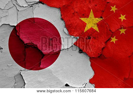 Flags Of Japan And China Painted On Cracked Wall