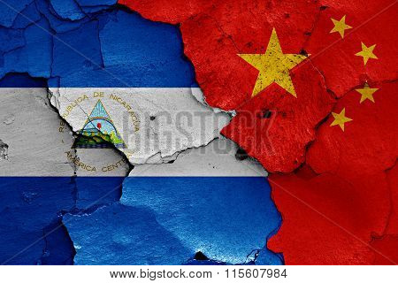 Flags Of Nicaragua And China Painted On Cracked Wall