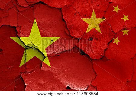 Flags Of Vietnam And China Painted On Cracked Wall