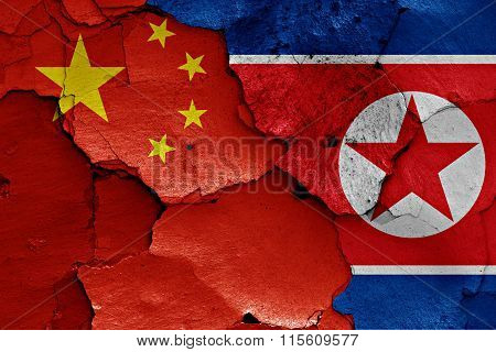 Flags Of China And North Korea Painted On Cracked Wall